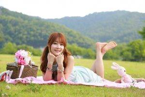 women, Model, Redhead, Long Hair, Women Outdoors, Depth Of Field, Looking At Viewer, Smiling, Asian, Lying On Front, Dress, Barefoot, Legs Up, Picnic, Flowers, Nature, Field, Grass, Hill, Trees, Forest, High Heels