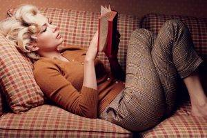 Michelle Williams, Lying Down, Curly Hair, Blonde, Women, Lying On Back, Women Indoors, Legs  Crossed, Long Hair, Books, Couch, Sweater, Pants, Reading
