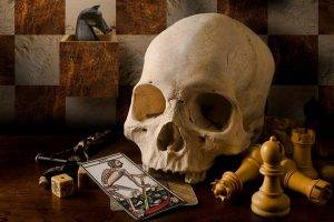 skull death playing cards chess dice pawns teeth horse checkered board games scythe cross jesus christ table wooden surface cube