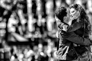 monochrome kissing couple bokeh