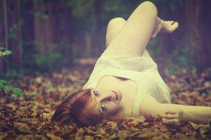 women lying down women outdoors depth of field nature leaves fall redhead dress white dress legs up blue eyes